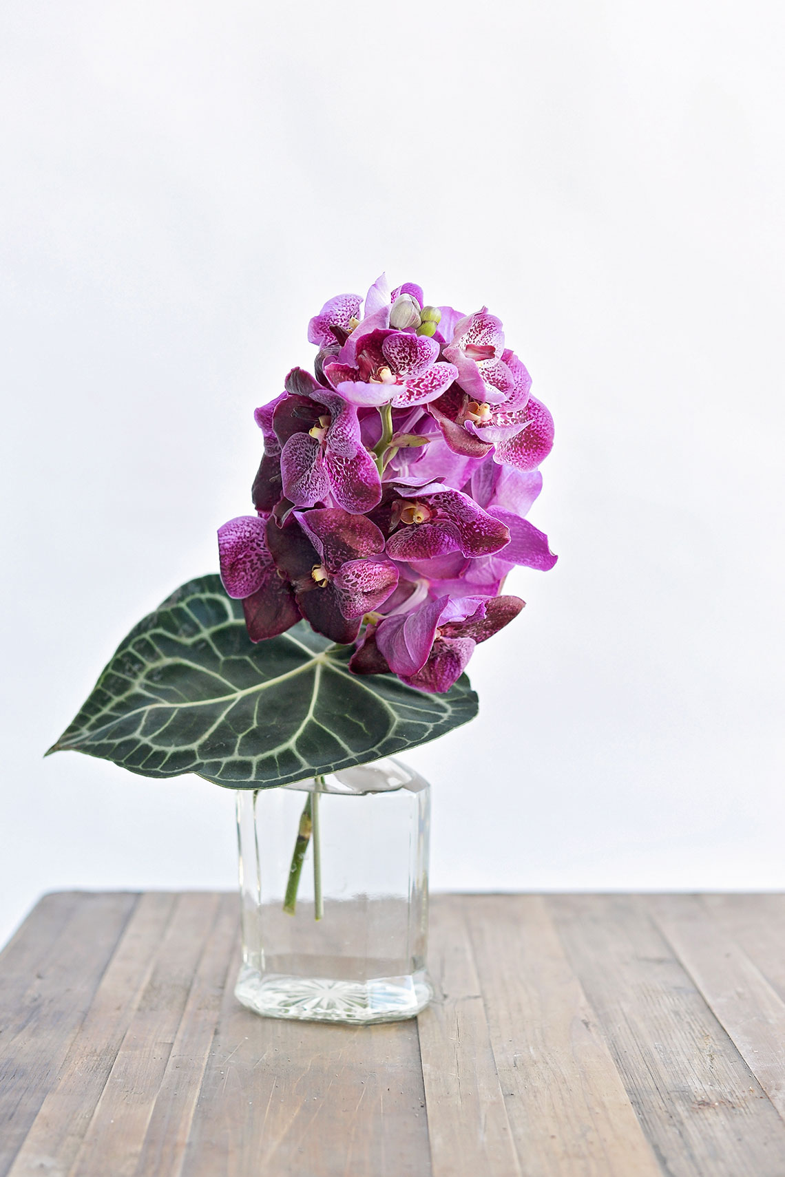 Corporate flowers in vase on bench